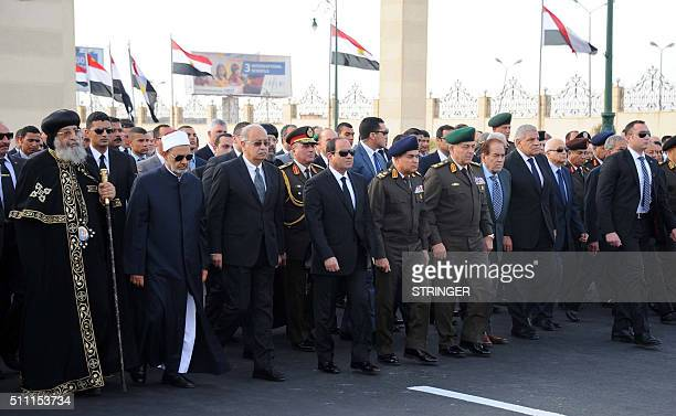 A handout picture released by the Egyptian Presidency shows Egyptian President Abdel Fattah alSisi walking with Coptic Pope Tawadros II of Alexandria...