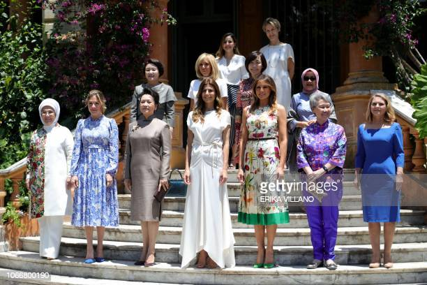 Handout picture released by the G20 Press Office showing the wives of the G20 leaders Turkish Emine Erdogan Canadian Sophie Gregoire Trudeau Chinese...