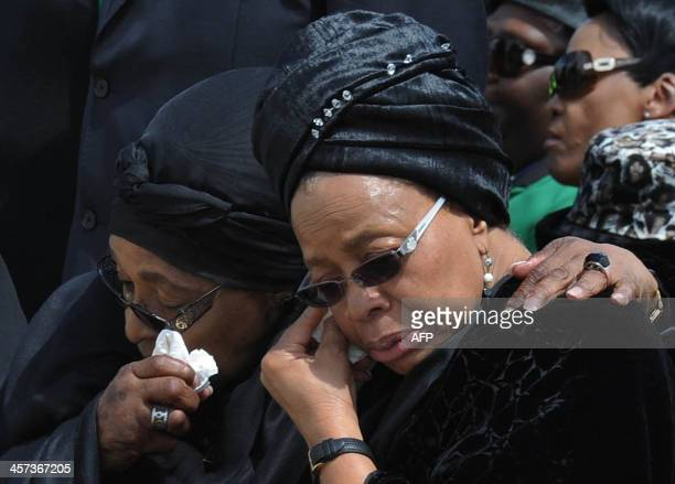 Handout picture released by the GCIS shows the exwife of Nelson Mandela antiapartheid campaigner Winnie Mandela Madikizela and his widow Graca Machel...