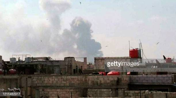 A handout picture released by the official Syrian Arab News Agency on May 1 shows smoke billowing above buildings in Syria's central city of Homs...