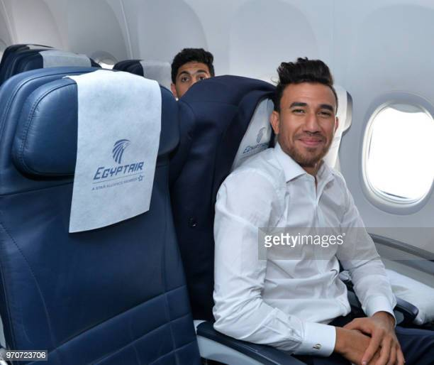 A handout picture released on June 10 by the Egyptian Civil Aviation Ministry shows Egypt's national football team midfielder Mahmoud Hassan...