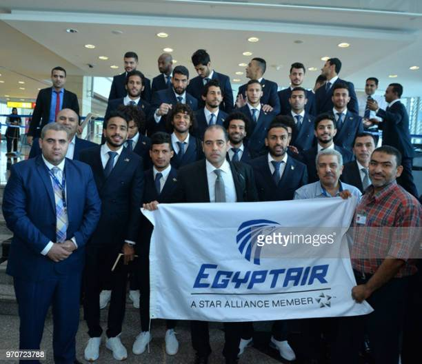 A handout picture released on June 10 by the Egyptian Civil Aviation Ministry shows the members of Egypt's national football team posing for a group...