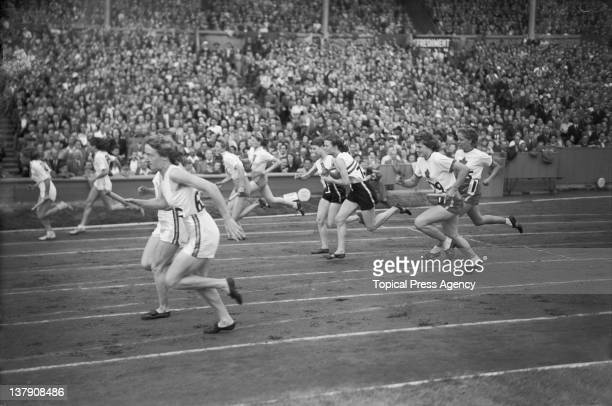 A handover during the final of the women's 400 metres relay at the Olympic Games Wembley Stadium London 7th August 1948 Two runners of the Australian...