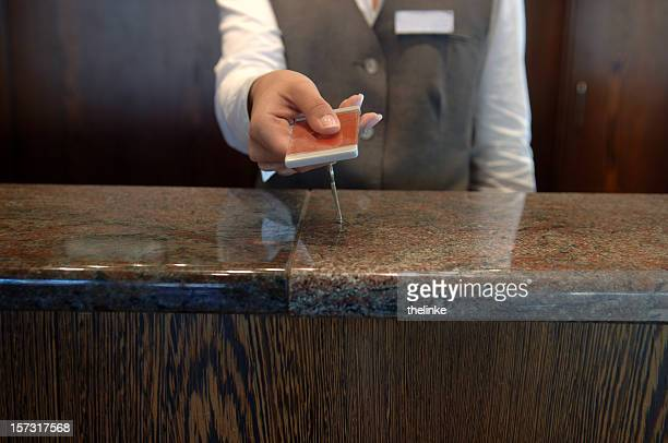 hand-over of keys in a hotel - hotel key stock photos and pictures