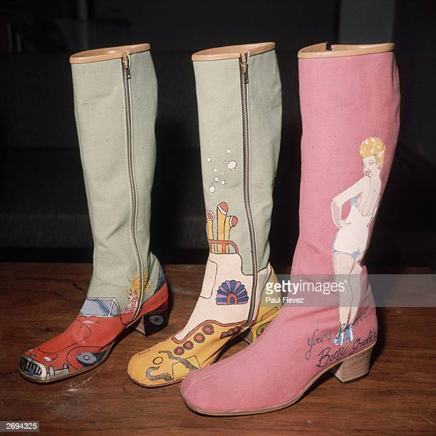 Handpainted boots by London shoe designer Richard Evans styled on the British pop group The Beatles' animated musical film 'Yellow Submarine' and the...