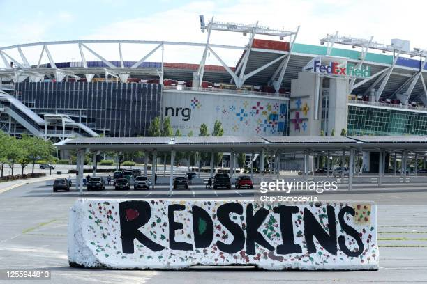 A handpainted concrete barrier stands in the parking lot of FedEx Field home of the NFL's Washington Redskins team July 13 2020 in Landover Maryland...