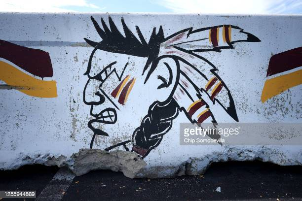Hand-painted concrete barrier stands in the parking lot of FedEx Field, home of the NFL's Washington Redskins team July 13, 2020 in Landover,...