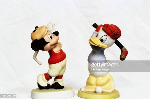 Handpainted golfing figures of Mickey Mouse and Donald Duck c1930s