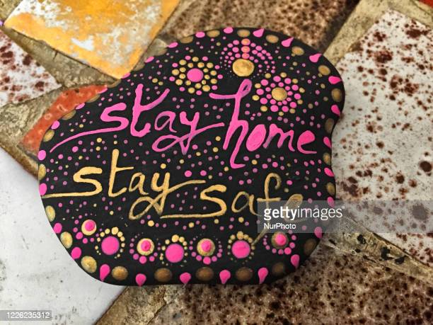 Hand-painted rock with the words 'stay home, stay safe' during the novel coronavirus Toronto, Ontario, Canada on June 26, 2020.