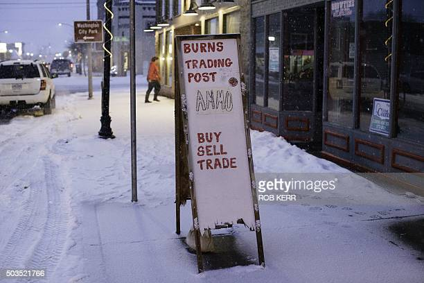 A handpainted sign for the Burns Trading Post advertises the sale of ammo along N Broadway Avenue in Burns Oregon January 5 2016 The small antique...