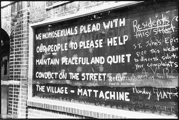 Handpainted text on a boardedup window of the Stonewall Inn after riots over the weekend of June 27 1969 The text reads 'We homosexuals plead with...