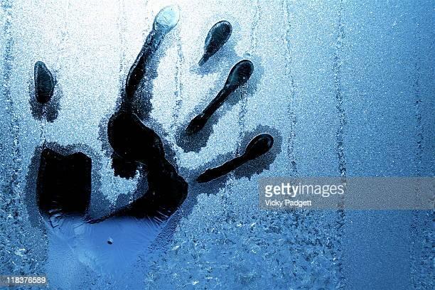 Handprint on frosty window