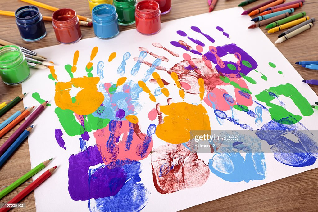 Handprints and art equipment : Stock Photo