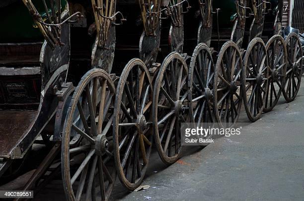 hand-pulled rickshaws at kolkata,west bengal,india - rickshaw stock pictures, royalty-free photos & images