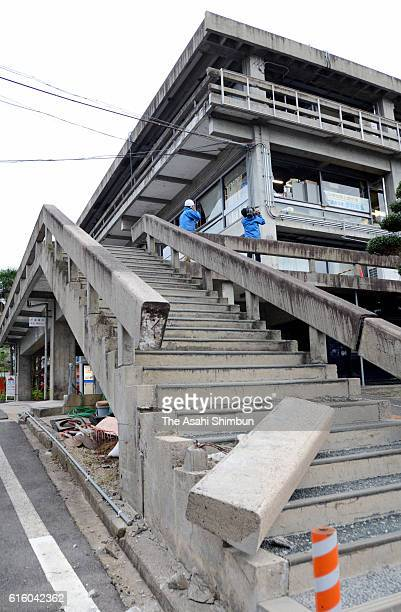 A handrail of the steps in front of Kurayoshi City Hall is damaged after the magnitude 66 earthquake hit the area on October 21 2016 in Kurayoshi...