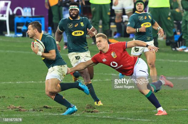 Handre Pollard of South Africa breaks away from Duhan van der Merwe during the 2nd test match between South Africa Springboks and the British & Irish...