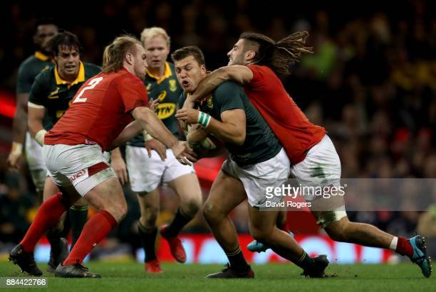 Handre Pollard of South Africa is high tackled by Josh Navidi of Wales during the international match match between Wales and South Africa at...