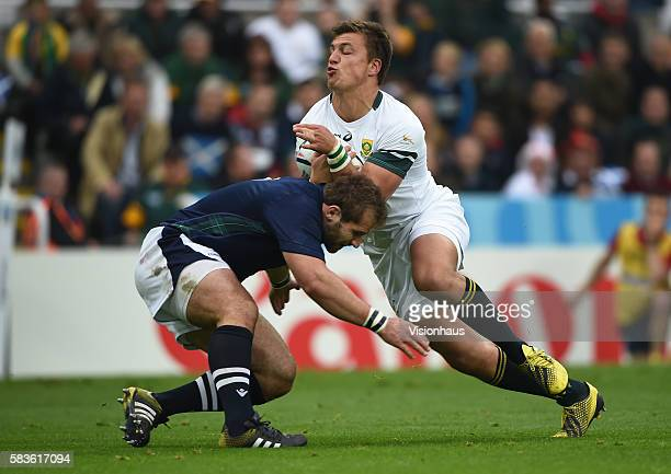 Handre Pollard of South Africa is tackled by Fraser Brown of Scotland during the Rugby World Cup Pool B match between South Africa and Scotland at St...