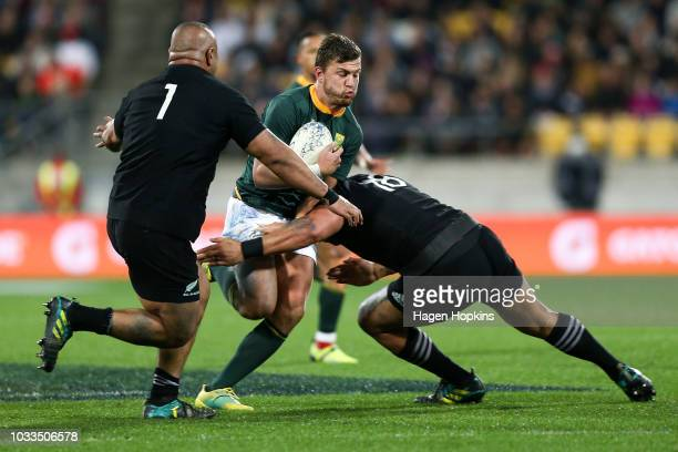 Handre Pollard of South Africa is tackled by Ofa Tu'ungafasi of New Zealand during The Rugby Championship match between the New Zealand All Blacks...