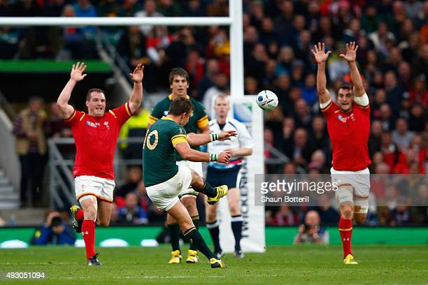 Handre Pollard of South Africa kicks a drop goal as Gethin Jenkins of Wales and Sam Warburton of Wales attempt to block during the 2015 Rugby World...
