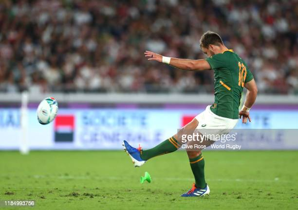 Handre Pollard of South Africa kicks to score his team's first penalty during the Rugby World Cup 2019 Final between England and South Africa at...