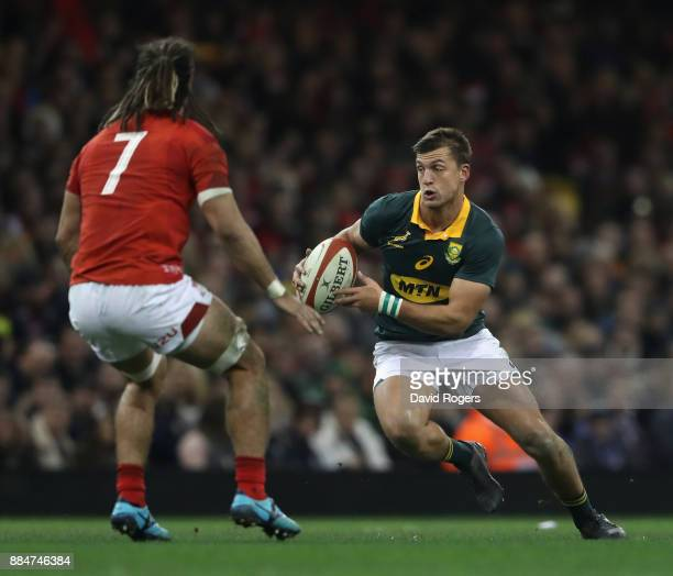 Handre Pollard of South Africa takes on Josh Navidi during the rugby union international match between Wales and South Africa at the Principality...