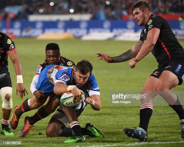 Handre Pollard of the Bulls scores a try during the Super Rugby match between Vodacom Bulls and Emirates Lions at Loftus Versfeld on June 15 2019 in...