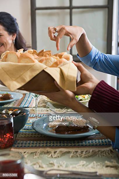 hands and basket of bread - mole sauce stock pictures, royalty-free photos & images