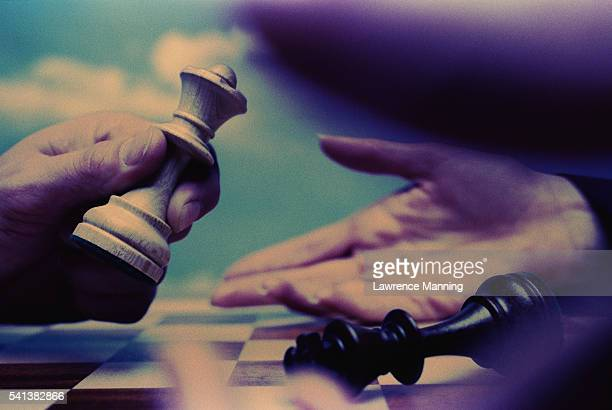 Hands and Chess Pieces