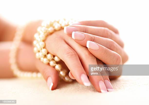 Hands and pearls.
