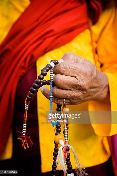 Hands and prayer beads.