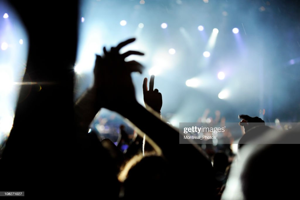 Hands at concert : Stock Photo