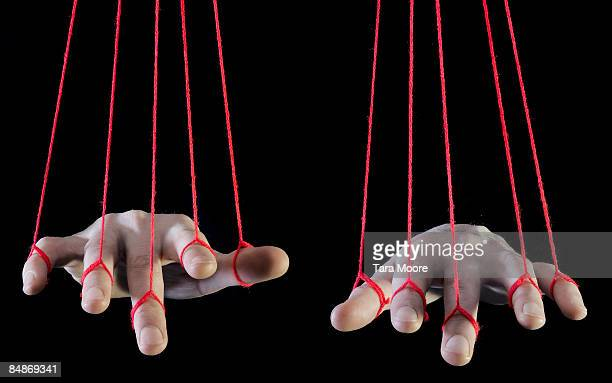 hands being supported by string - puppet stock pictures, royalty-free photos & images