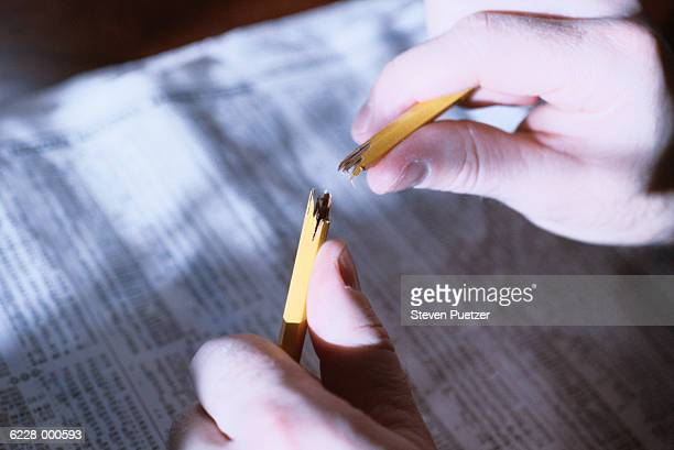 Hands Breaking Pencil