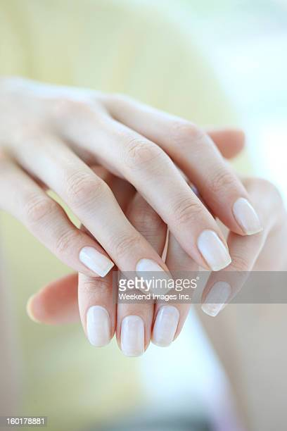 hands care - hand cream stock photos and pictures