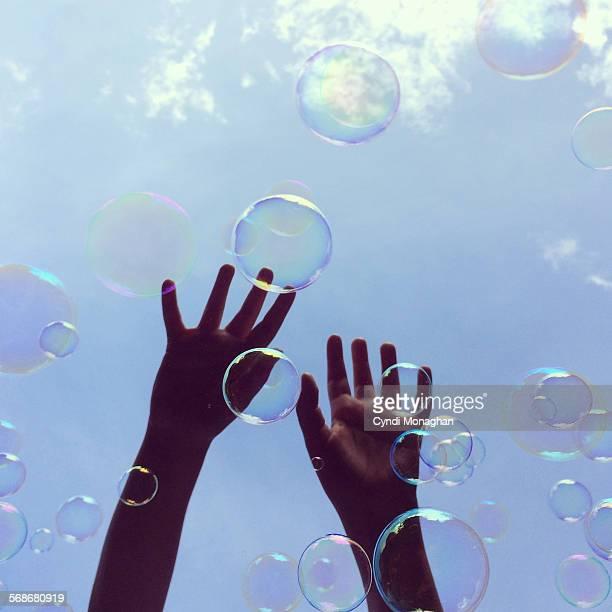 Hands Catching Bubbles