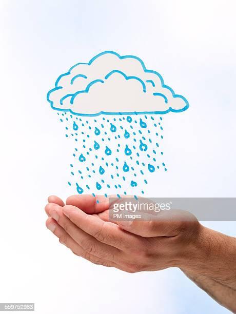 Hands catching illustrated rain