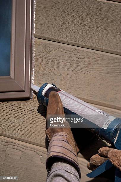 Hands caulking window
