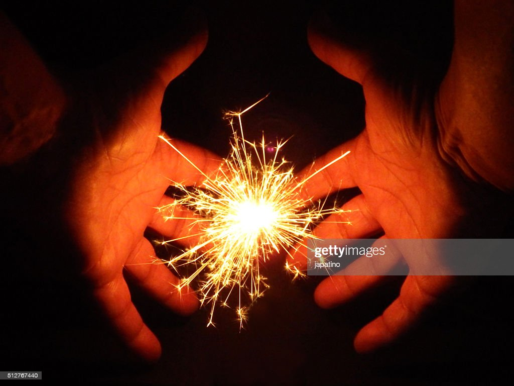 hands circling a star : Stock Photo