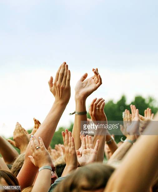 hands clapping in crown outdoors - music festival stock pictures, royalty-free photos & images