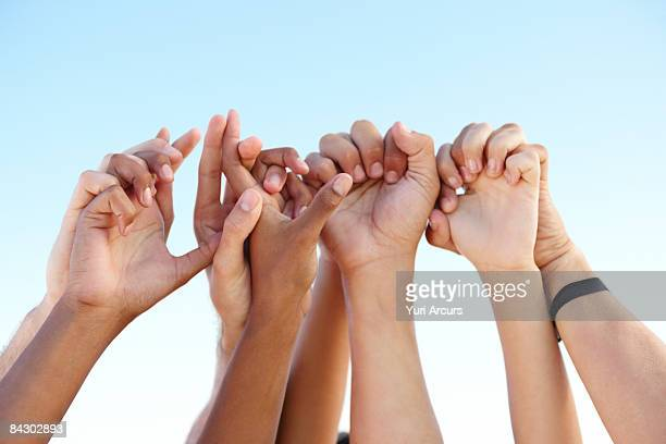Hands clasped in solidarity
