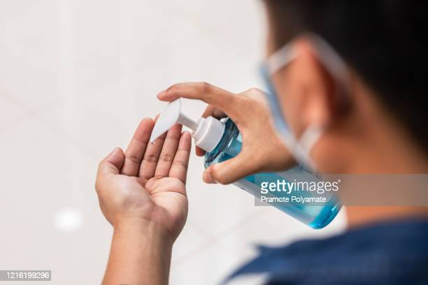 hands closeup men washing hands with alcohol gel or antibacterial soap sanitizer. hygiene concept. prevent the spread of germs and bacteria and avoid infections corona virus [covid-19] - gota condição médica - fotografias e filmes do acervo
