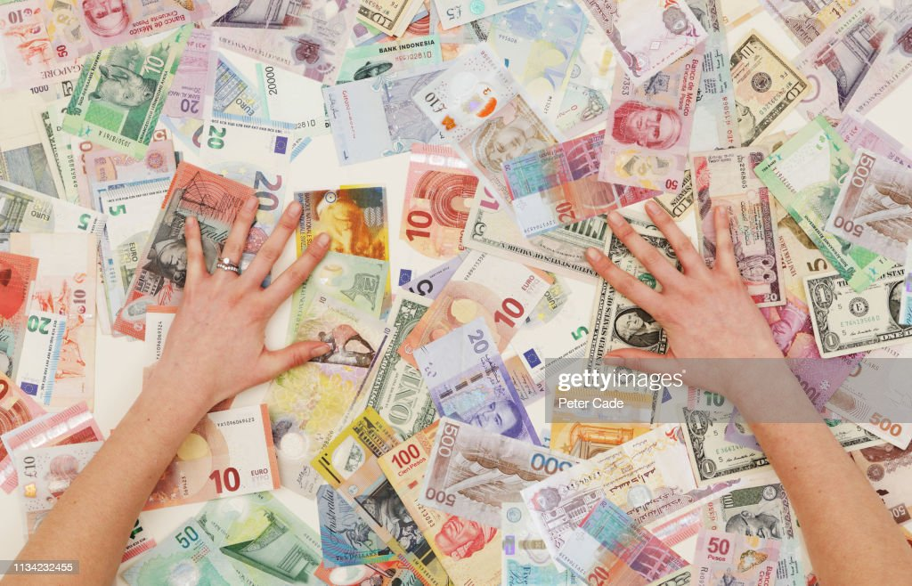 hands counting foreign currency : Stock Photo