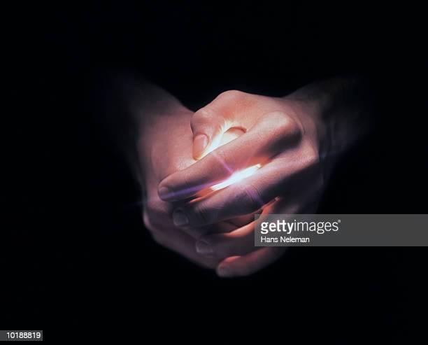 Hands covering white light