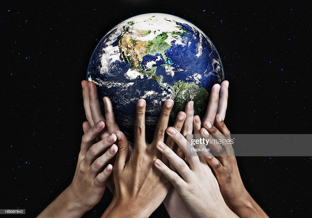 Hands cradling Mother Earth against starfield background : Stock Photo