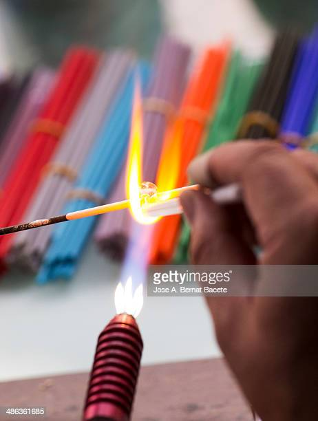 hands creating jewelry glass jewelry - blowpipe stock pictures, royalty-free photos & images