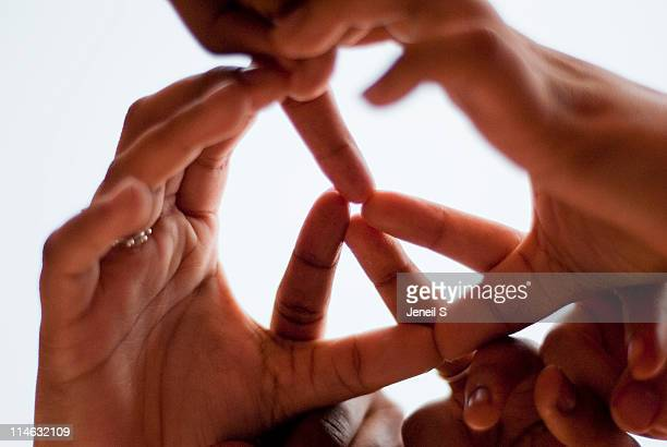 Hands creating peace sign