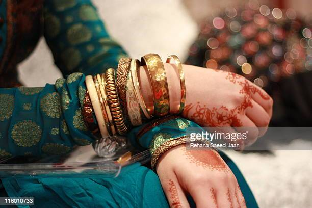 hands crossed hand - bangle stock pictures, royalty-free photos & images