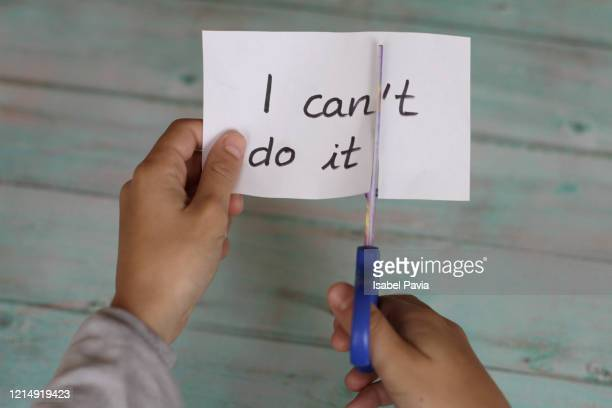 hands cutting paper with i can't do it text - possible stock pictures, royalty-free photos & images