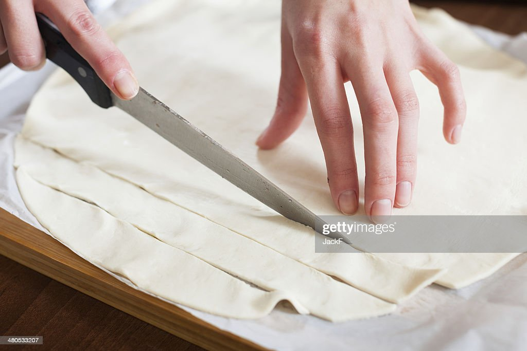 hands cutting store-bought dough : Bildbanksbilder